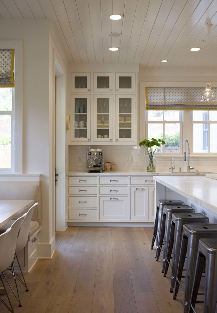 Kitchen love... Light wood floor, wood boarded ceiling, large island, eat in space, cabinets