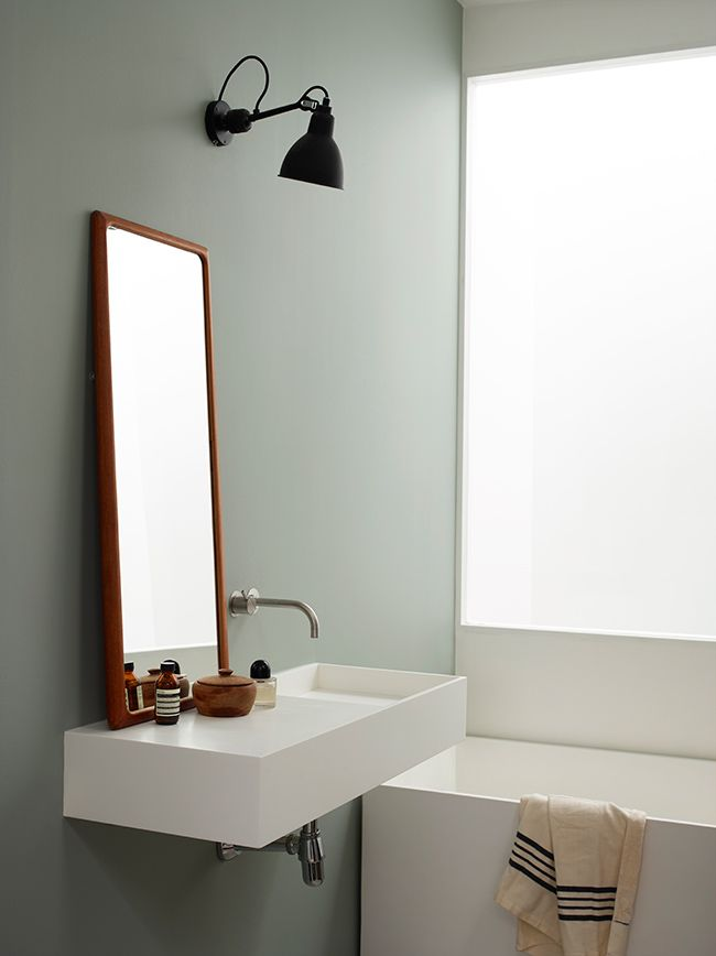 A Dusty mint green colour that compliments the orange hue in the teak wood. The green is light enough to not create a large contrast to the white porcelain. Complimentary colours and low contrast gives a soothing palette for a bathroom. A lovely green colour from Jotun LADY Aqua, called 7163 Minty Breeze.