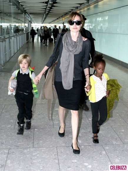 angelina jolie traveling style. good airport attire. slip on shoe's (preferably worn with no-show nylon 'socks' so you're not barefoot when you have to put your shoes threw the scanners), loose comfy clothes, no belt...