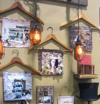 These hangers used to display layouts, photos, or pieces of art fit well into altered art booth