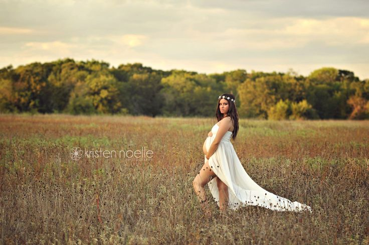 Love this for maternity pictures. flow-y dress and flower crown and cowgirl boots during a sunset in a field somewhere. :)