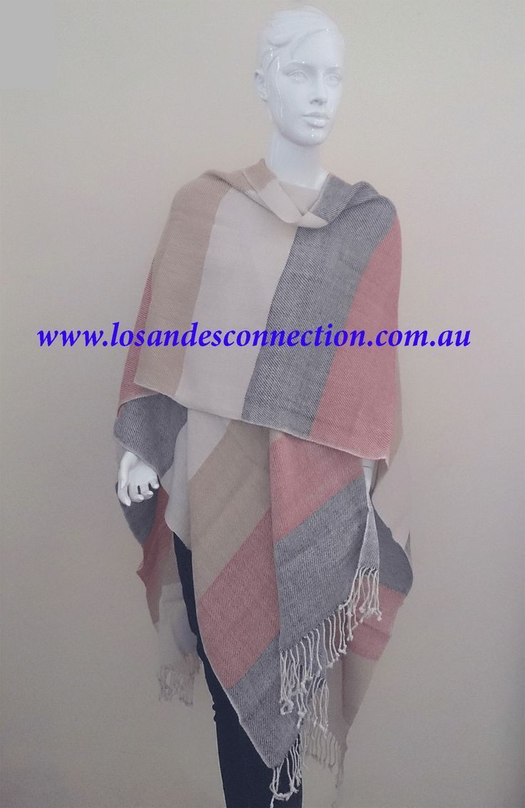 STYLISH CAPE ,Lightweight Cape made from a luxurious Baby Alpaca fringe and striped print along the edges. Perfect combination colours, belong to our hand woven line, with ancient weaving techniques.