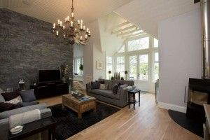Decarock Natural Stone Cladding in Natural Slate creates a focal point for this stunning front room.