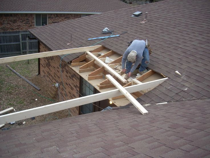 how to attach a patio roof to an existing brick house
