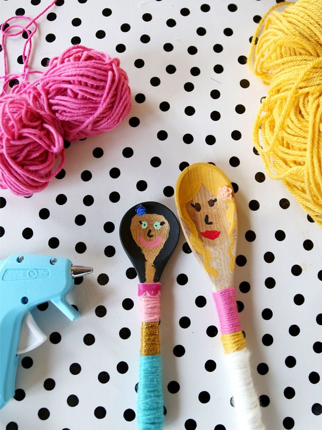 Wooden spoons painted and wooled like family
