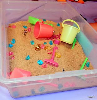 If you can't get outside to do a pirate treasure hunt - try doing a sensory one inside, with a bit of sand, or yellow dyed sugar! Hide some jewels, coins, earrings, a patch, maybe even a small ship or parrrot int he sand box, and watch your child learn! From 12 - 18 months, put the container on a mat or tarp, to collect any spillage, but you can expect your child to be imitating word sequences during play with them, like 'put it in' or 'take it out' .