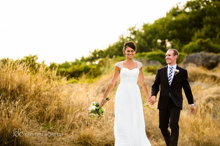 Bride and groom walking in long grass on wedding day (Kristen Borelli Photography, Victoria Golf Club Wedding Photography, Victoria Wedding Photographer, Victoria Wedding Photography, Nanaimo Wedding Photographer, Nanaimo Wedding Photography, Vancouver Island Wedding Photographer, Vancouver Island Wedding Photography, Prince George Wedding Photographer, Prince George Wedding Photography)