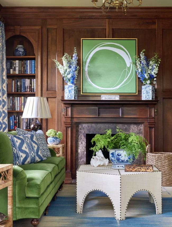 Sarah Bartholomew - love the sofa & the rich wood paneling