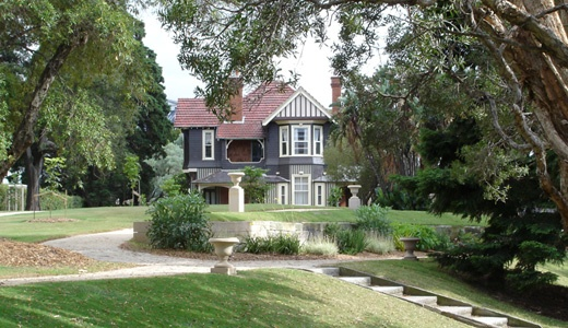 2 storey house. The Chalet, built in 1890–1891 adjacent to Government House, designed by NSW Government Architect Walter Liberty Vernon in the spirit of the Queen Anne style, which heralded the development of the Australian Federation style. Tudor elements are timbered gables, broad brick chimneys and an oriel (upper-storey bay) window. Text courtesy of the HHT