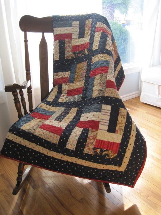 Quilt I made for my son using a Flag Day Farm Jelly Roll. I love the American colors!