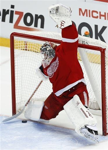 Detroit Red Wings goalie Jonas Gustavsson, of Sweden, stops a Chicago Blackhawks right wing Patrick Kane shot in a shootout