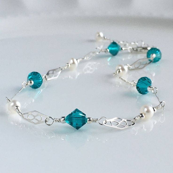 Dainty Silver Ankle Bracelet Adjustable, Silver Crystal Wedding Anklet, Sterling Silver Anklet, Something Blue Anklet, .925. **Sterling Silver Ankle Bracelet Freshwater Pearls and Blue Zircon Swarovski Crystals** Something Blue for your wedding. This silver ankle bracelet is made with Swarovski crystals and freshwater pearls. This is a wonderful anklet for a wedding or any special occasion. This is also available in 14k gold filled. This anklet comes in a box ready for gift giving. To...