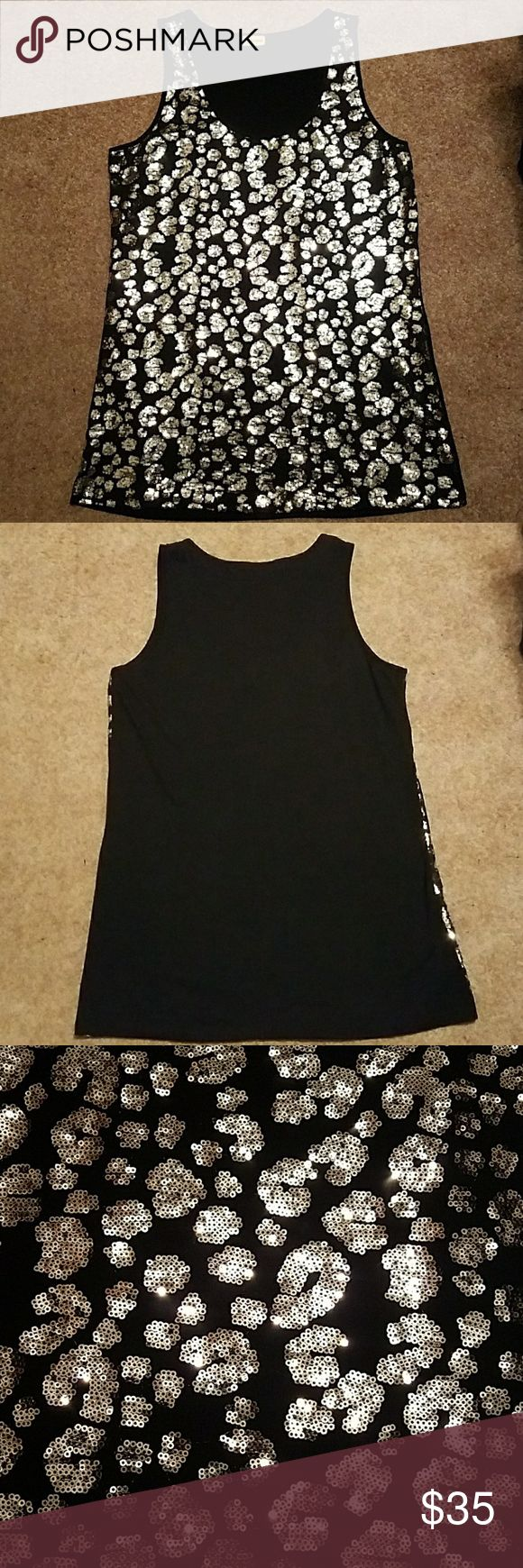 Sleeveless Sequence Dress Black comfy dress with silver sequence only on the front. Back is solid black comfy, soft, and stretchy material. Cut size of tag out, but Woman's size XL. Measures 20 inches wide and 33 inches long. Worn once on New Year's. Smoke free home. Make an offer!! Wildcat Dresses