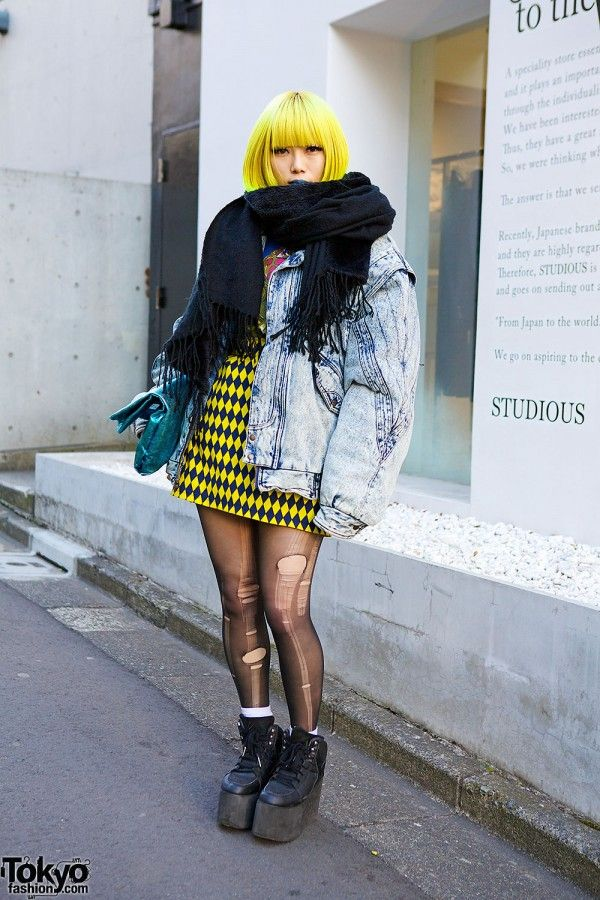 Murakami is a 23-year-old girl who easily caught our eye on the street in #Harajuku. Her look features a yellow bob hairstyle with blue lipstick, an oversized acid wash jacket (resale), a metallic clutch (from Nadia), ripped tights, a Jeremy Scott x Swatch watch & YRU platforms. #tokyofashion #street snap ....When a good girl gone bad... they made a stop at ZOOJI <3 where wine is served all day ;] Chic.St Approved <3
