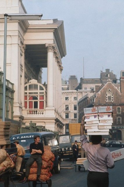 A porter using his head to help carry flowers at Covent Garden market, London around 1970.
