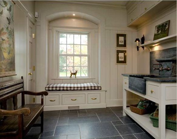 is a serious mudroom with slate floors and a beautiful soapstone sink ...
