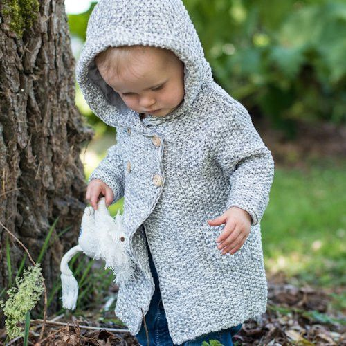 Beba Bean Crochet Knit Hoodie  This adorable crochet knit hoodie is made with all cotton fibers and has handcrafted wooden buttons. The oversized hood is perfect for taking the chill out of cool days!   100% cotton, machine wash, tumble dry low