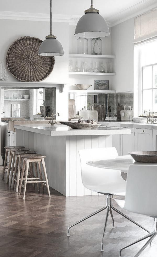 I love the all white look in this kitchen.....open flowing space...and the white makes it look even more that way......