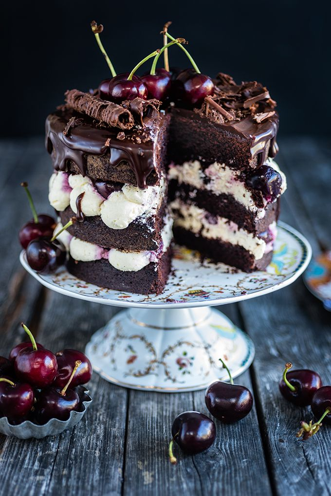 This Eggless easy Black Forest layer cake is sandwiched with sweetened whipped cream and cherries and topped with chocolate ganache, fresh cherries and chocolate curls. Pure indulgence!