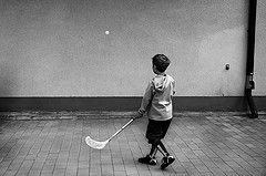 The Wall Inspector.. (Peter Levi) Tags: street city boy blackandwhite bw blancoynegro wall kid child sweden stockholm streetphotography floorball hockeystick x100 housewall landhockey fujifilmx100 fujix100 fujifilmfinepixx100