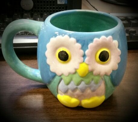 An owl mug painted with lots of imagination!