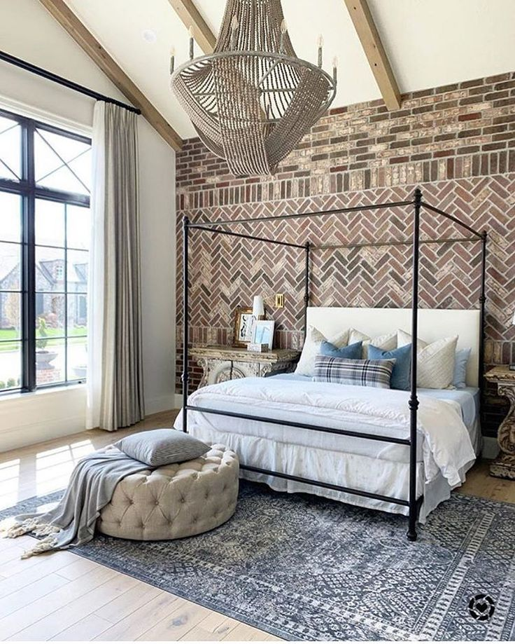 Love the interest that the brick wall adds to this bedroom