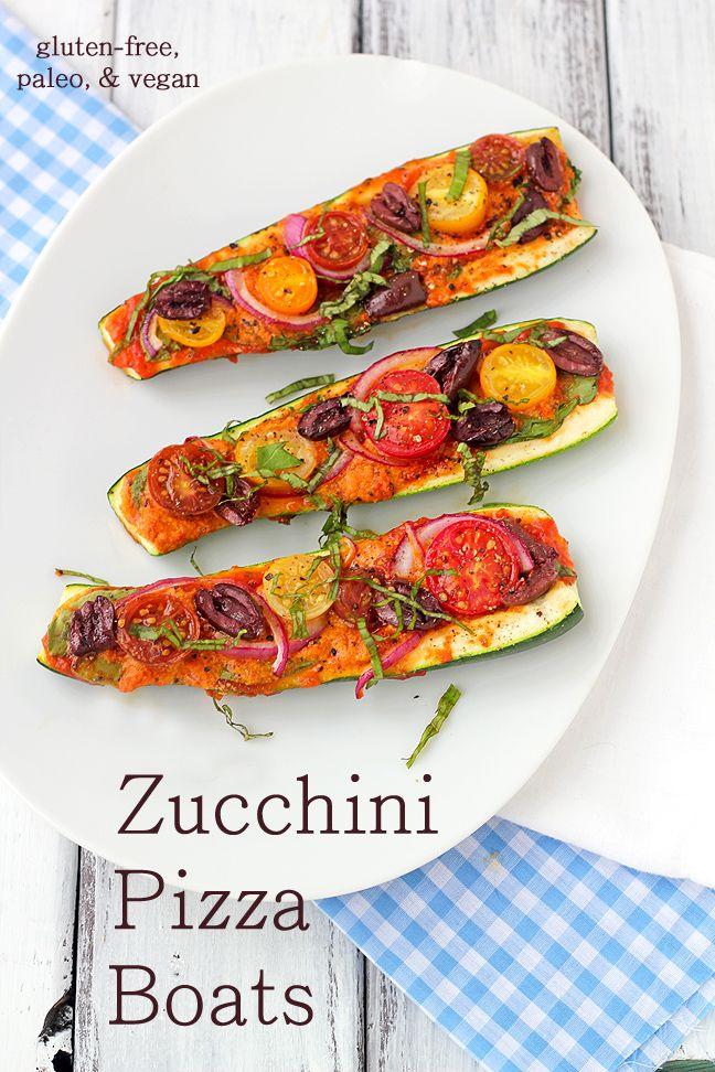 Zucchini Pizza Boats - zucchini, marinara or pizza sauce, nutritional yeast (optional), red onion, kalmata olives, cherry tomatoes, fresh basil chiffonade