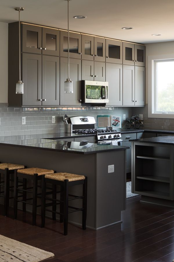 these glass front kitchen cabinets extend to the full height of the 9 foot ceilings in this on kitchen cabinets to the ceiling id=21088