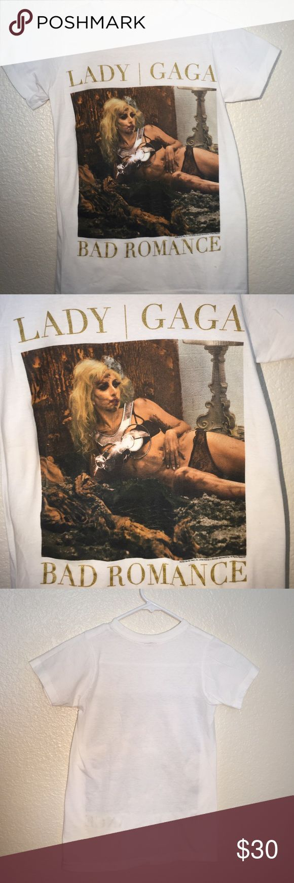 "BNWOT limited edition Lady Gaga ""Bad Romance"" Brand new without tags limited edition Lady Gaga ""Bad Romance"" t-shirt. Absolutely love this but have Had it for years and have never worn it. Shirt features my favorite scene from the bad romance video. This shirt needs needs to go home to a little monster that will love it way I should have. 💕💕💕 Lady Gaga Tops Tees - Short Sleeve"