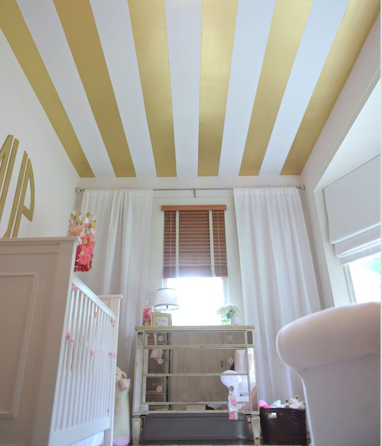 Gold Striped Ceiling in this Pink and Gold Nursery - so glam!