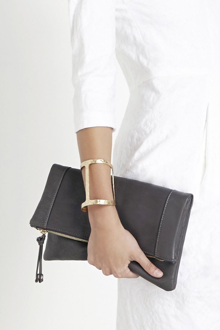 Luxuriously soft vegan leather foldover clutch that stores all your essentials