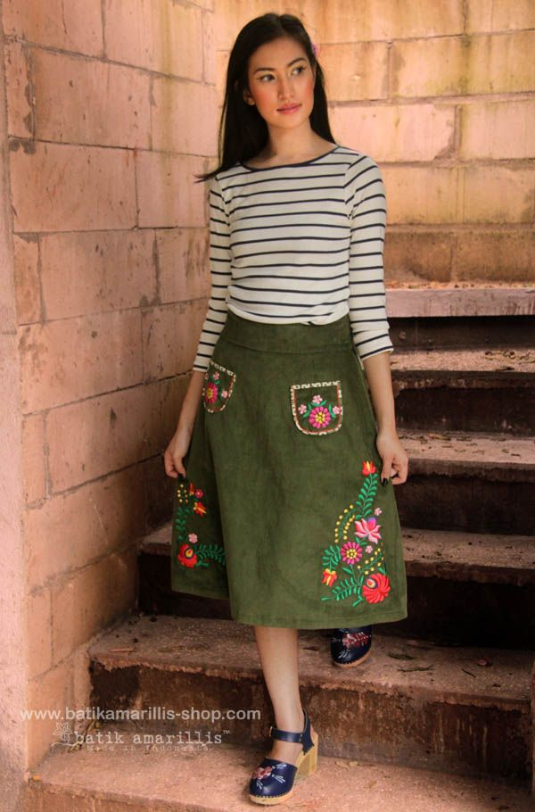 batik amarillis's folkloric embroidery skirt Flattering skirt with Hungarian folkloric embroidery style,accented with embroidery aplique pockets & batik piping.