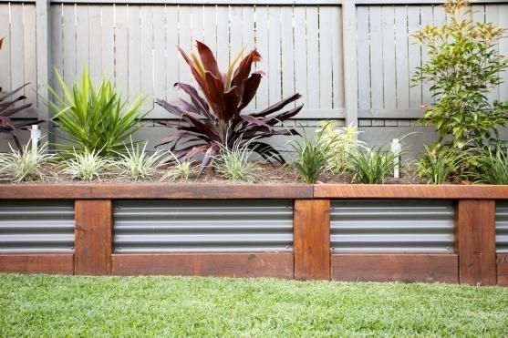Retaining Wall Design Ideas by Utopia Landscape Design - This page has lots of different wall designs and materials.