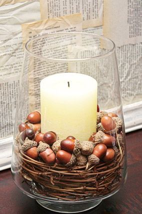 """Set the Scene with a 5-Minute DIY  """"A centerpiece—whether it's on your coffee table, dining room table or in a breakfast nook—is an easy way to make a big impact. I like cutting apart grapevine wreaths and placing them around a tall candle in a large vase. It takes just a few minutes to put together, and it costs less than $10."""" — Kelly Rowe, founder of LiveLaughRowe.com   Autumn decorating tips"""