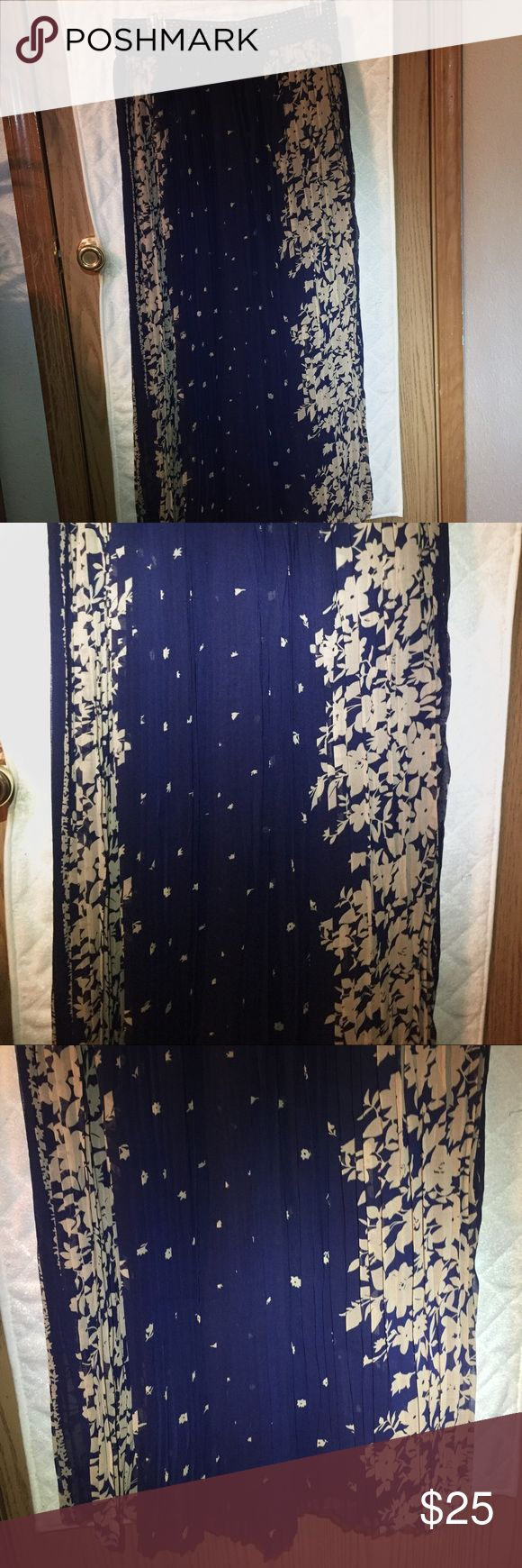 Navy blue and tan pleated floral long skirt Navy blue and tan pleated long skirt. Attached navy belt with shimmering silver dots. NWOT. Size 1X Skirts