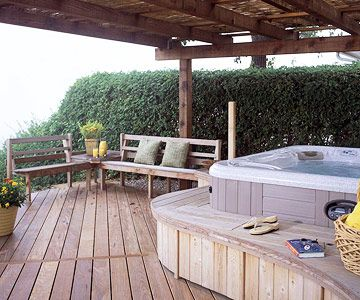 A fujidana -- a Japanese-style structure -- made with all-heart California redwood and topped with bamboo stakes, provides shade over the entire deck.