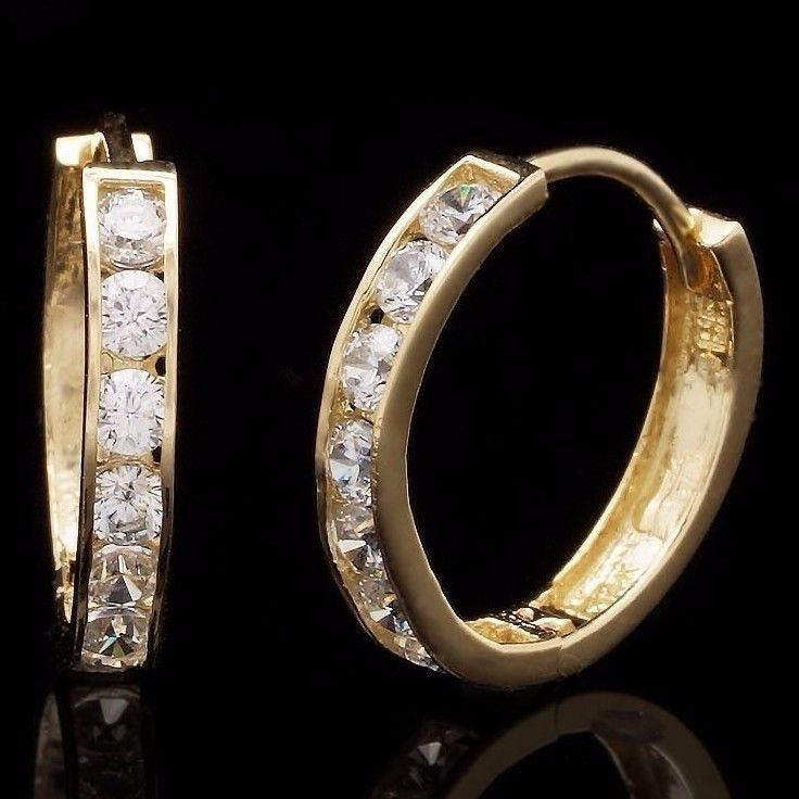 The fine pair is crafted in pure 14k gold, and is complemented tremendously with simulated diamonds, being a great everyday accessory. Our simulated diamond earrings are cut exactly like real diamonds with the same number of facets for optimal sparkle and they are super hard just like the real...