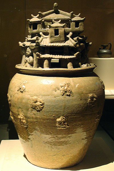 A celadon hunping jar with sculpted designs of architecture, from the Jin Dynasty (265-420).