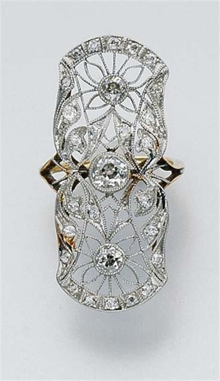 Beautiful vintage diamond filigree ring.   Platinum, gold, 28 diamonds ap. 1.00 ct., c.