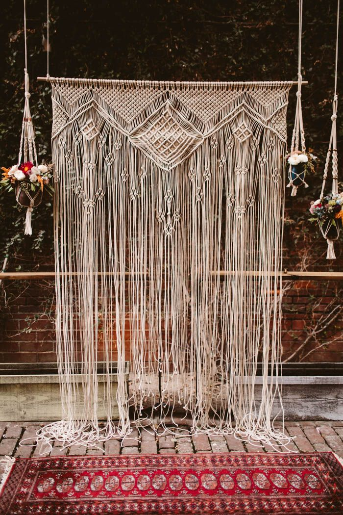 Macrame backdrop from this artistic Los Angeles wedding at Daily Dose Cafe | Image by Allison Harp