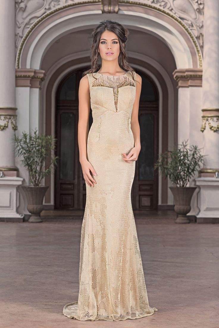 Walk the red carpet in style wearing this exquisite evening dress by Vero Milano!The illusion bodice has sheer rhinestones and has a sweetheart lining for a chic style and a glamorous train.