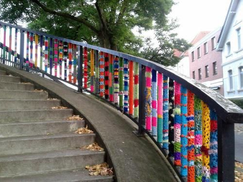 yarn bomb railing!  Photo/image credit unknown.