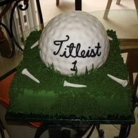 All fondant golfball with sugar tees and royal icing grass.  I made a separate flag but it does not appear on this picture.  That was made out of gumpaste.  Thank you for viewing this picture!