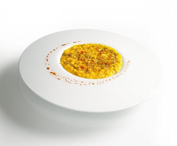 Massimiliano Alajmo's Saffron Risotto with Liquorice Powder   Italy Magazine (I'd leave out the licorice tho)
