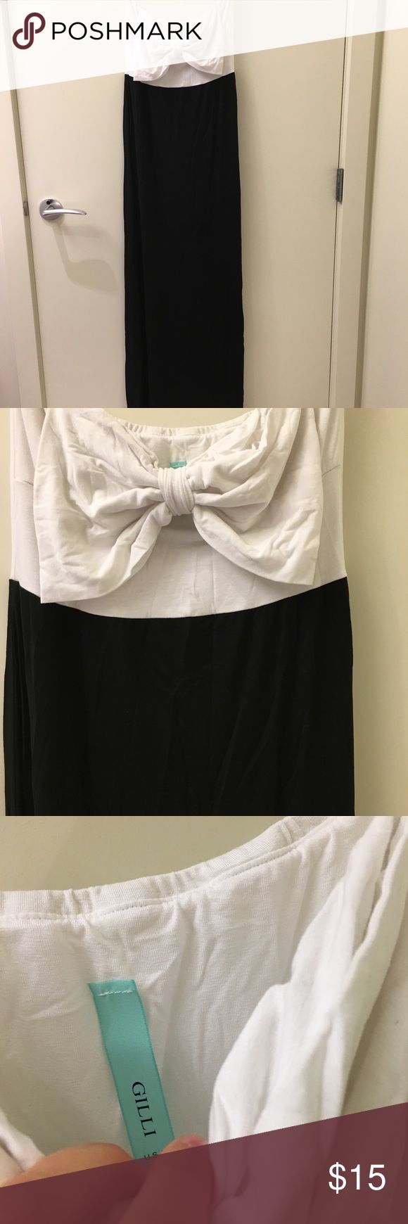 Black and white maxi dress - BRAND NEW Brand new black and white maxi dress with a bow accent. Dress is strapless and brand new never been worn. Gilli Dresses Maxi