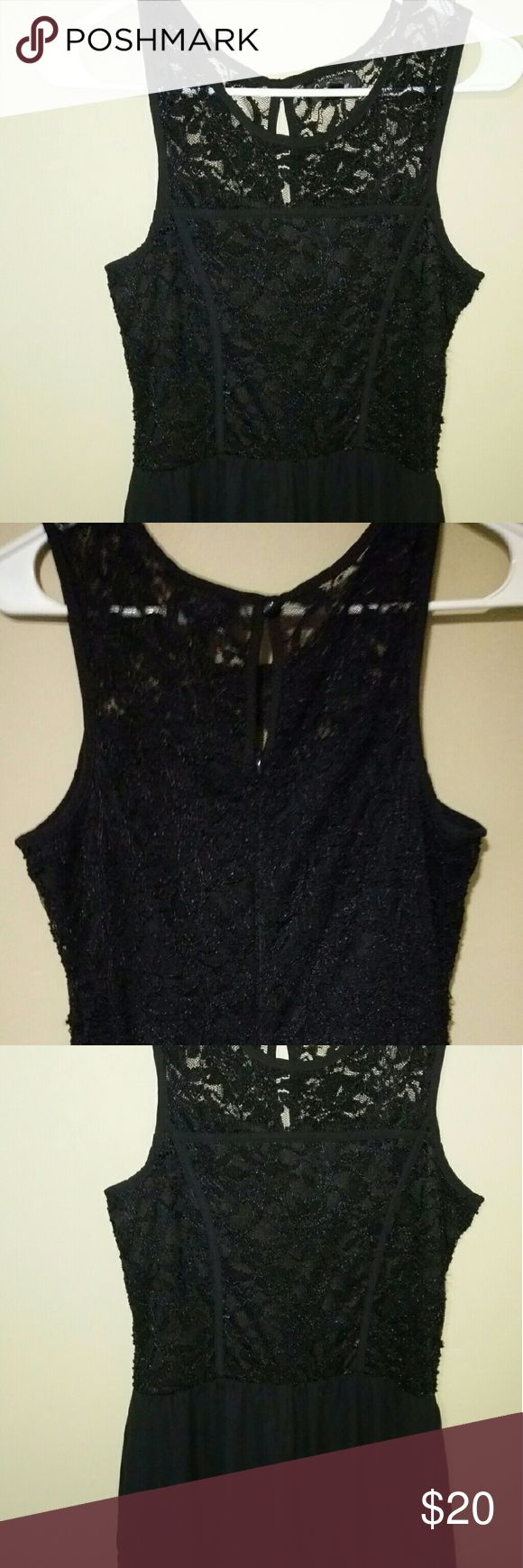 Ladies Romper, the lace on this piece really bring The black lace on this piece really beings the black out. Has been worn once but in excellent Shape. Shorts