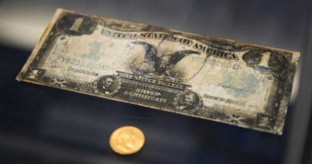 A silver certificate from the RMS Titanic is on display during a news conference by Guernsey's Auction House January 5, 2012 aboard the Intrepid Sea, Air & Space Museum in New York. Guernsey's announced the historic auction of the complete collection of artifacts recovered from the wreck site of RMS Titanic. (DON EMMERT, AFP/Getty Images)