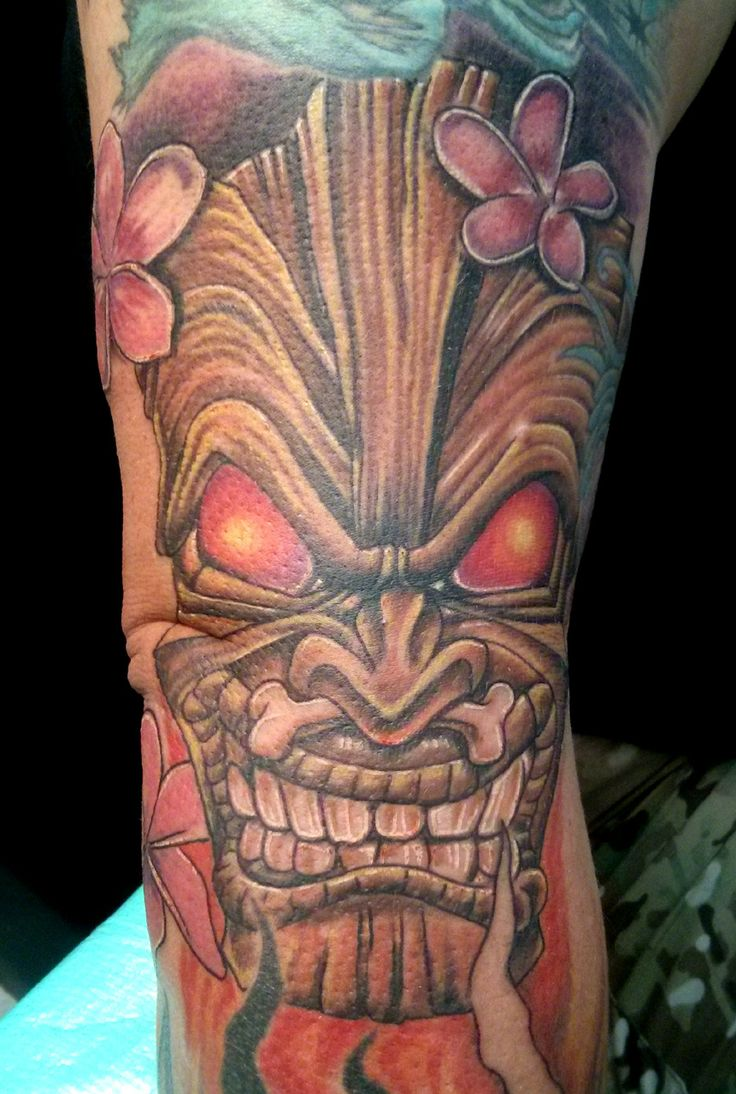 Tiki Mask tattoo with Plumeria.