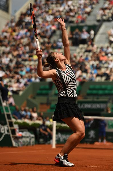 Simona Halep Photos - Simona Halep of Romania serves during the Ladies Singles third round match against Naomi Osaka of Japan on day six of the 2016 French Open at Roland Garros on May 27, 2016 in Paris, France. - 2016 French Open - Day Six