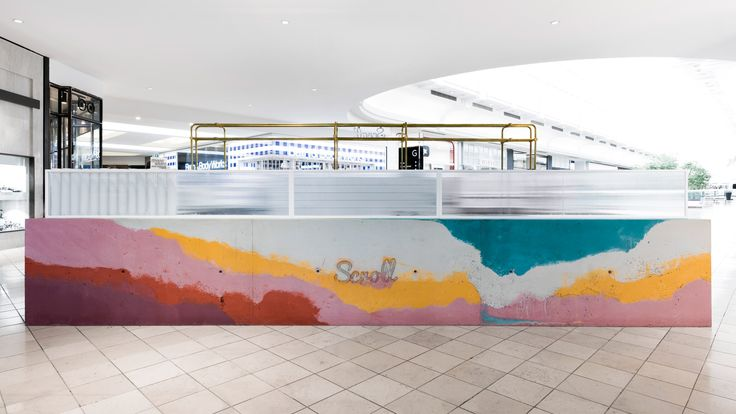 Multicoloured concrete bar forms ice cream stand inside Victoria shopping centre
